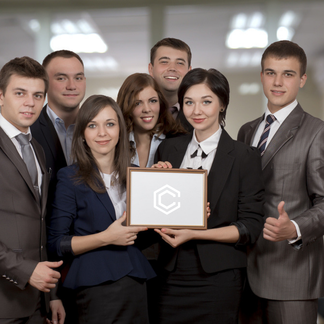 Group of employees holding an award